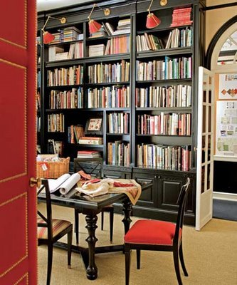 Library-built-ins-bookshelves_black-brown-red-nailhead-door_atelier-branca-designerdigs_traditional-home