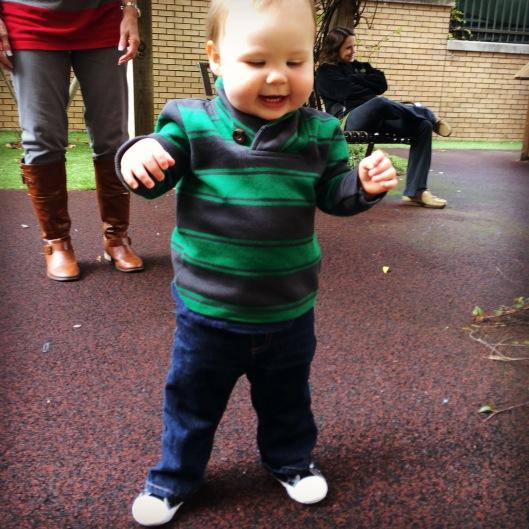 Showing off his walking skills when we visited his school last week.
