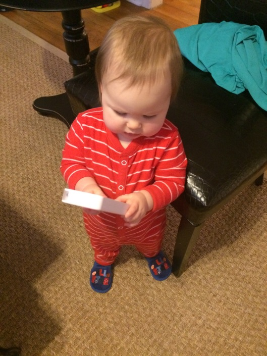 Christmas morning PJs and slippers...and his new phone from Uncle Rich and Aunt Ardith!
