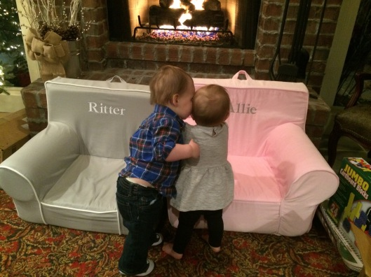 Giving kisses to cousin Allie on Christmas!