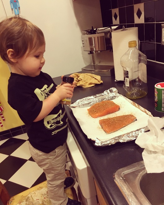Great example of following directions... teaching him how to shake the spices on the fish and making sure not to touch it. He is such a good helper!